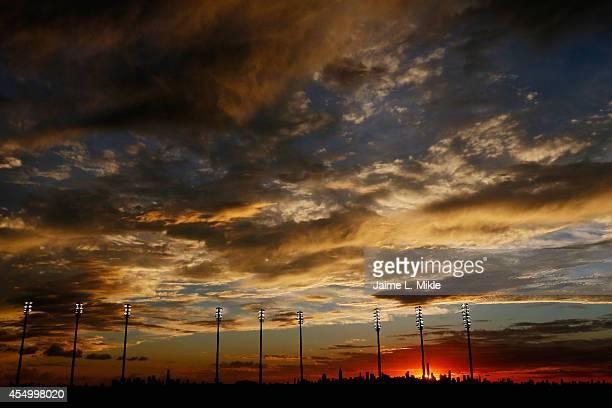 The New York City skyline is seen beyond Arthur Ashe Stadium as Marin Cilic of Croatia plays against Kei Nishikori of Japan during their men's...