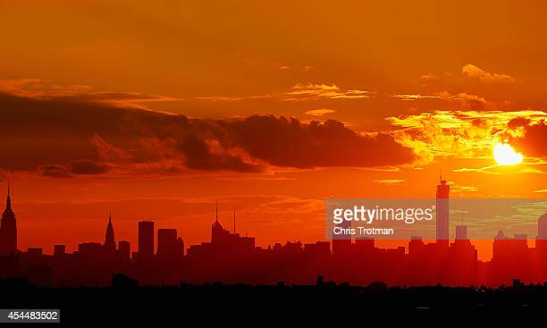 The New York City skyline is seen from Arthur Ashe Stadium as the sun sets on Day Eight of the 2014 US Open at the USTA Billie Jean King National...