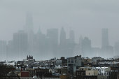 The New York City skyline is shrouded in snow on January 26 2015 in the Brooklyn borough of New York City Much of the Northeast is bracing for a...