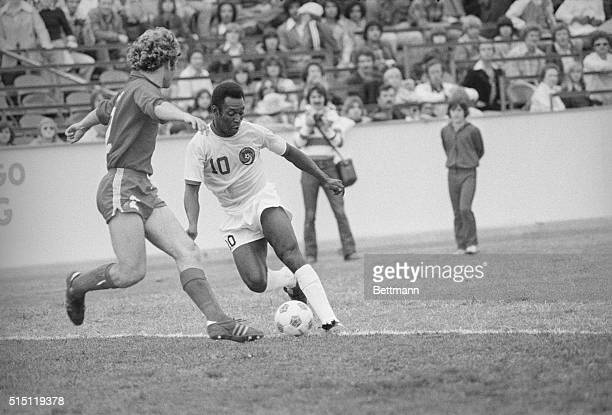 The New York Cosmos' Pele dribbles past the Dallas Tornado's Neil Cohen during the Cosmos' 10 exhibition victory in Dallas Pele scored the only goal...