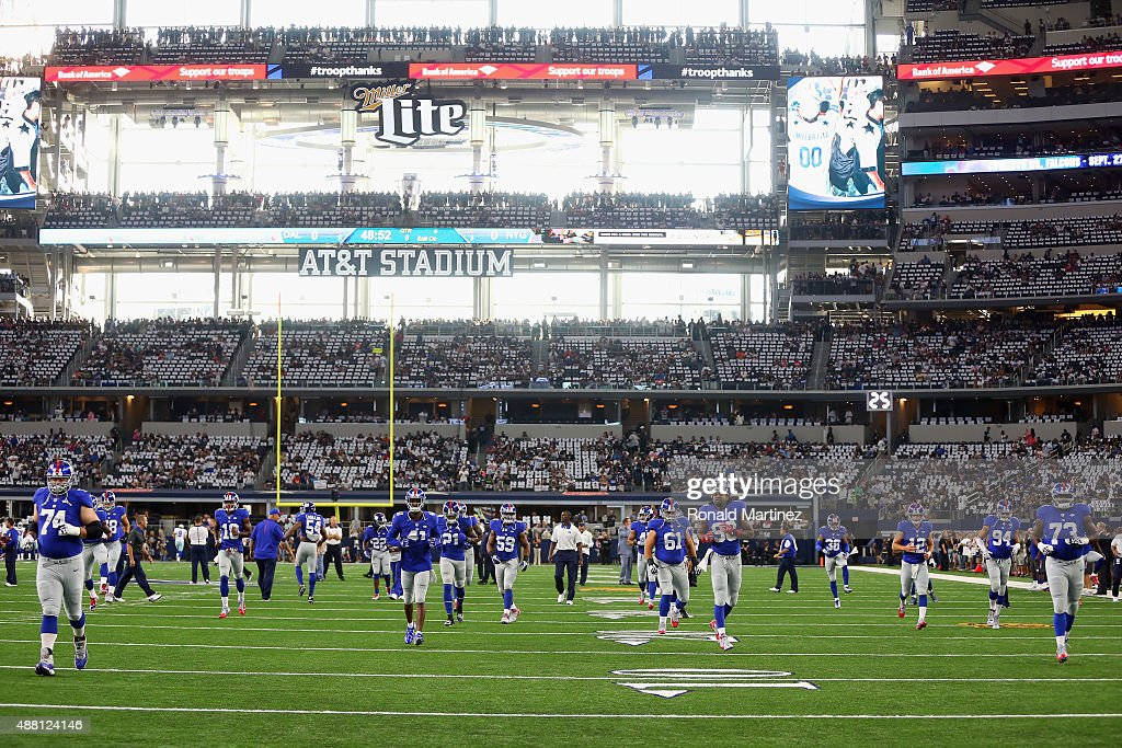 The New York Giants stretch before a game against the Dallas Cowboys at ATT Stadium on September 13 2015 in Arlington Texas