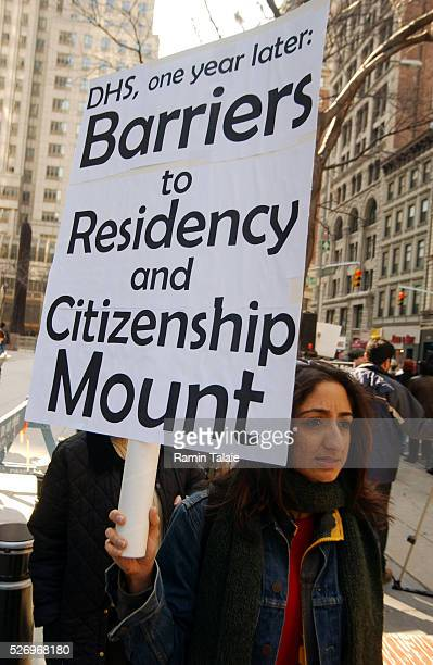 The New York Immigration Coalition and their supporters rally outside 26 Federal Plaza after releasing a 1st year report card on the Department of...