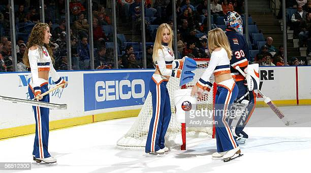 The New York Islander ice girls clean the ice around the goal of Islander goaltender Garth Snow during a timeout against the Tampa Bay Lightning...