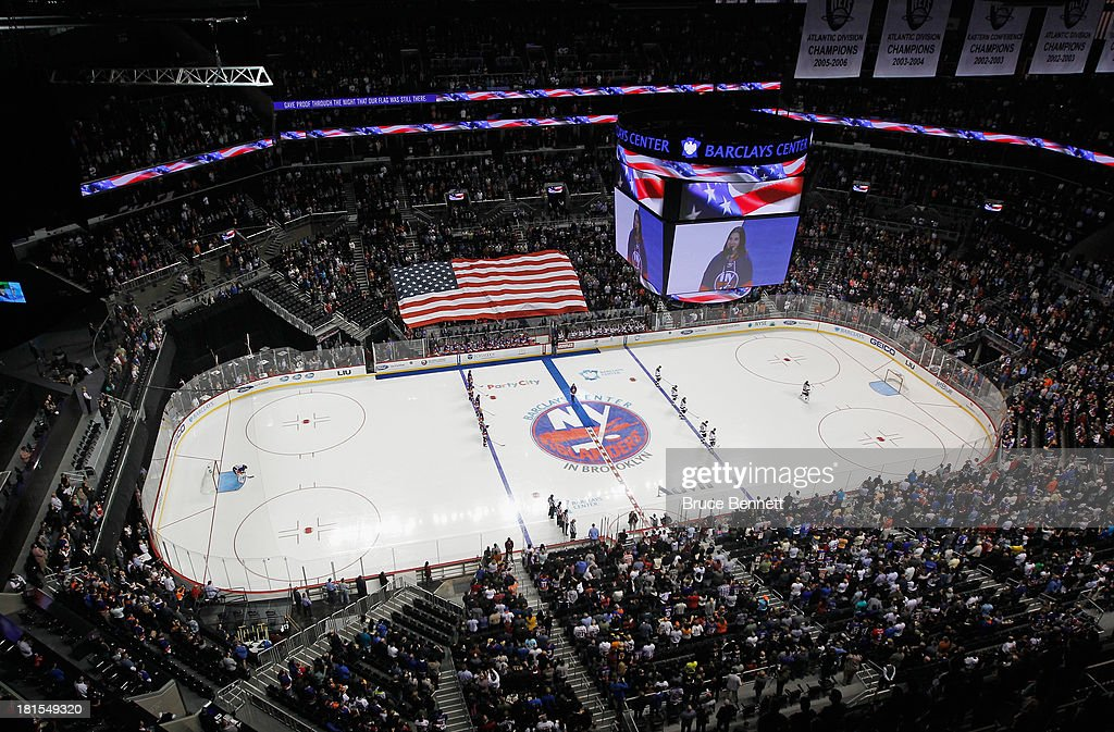 The New York Islanders and the New Jersey Devils stand at attention during the national anthem prior to a preseason game at the Barclays Center on September 21, 2013 in Brooklyn borough of New York City.The game is the first professional hockey match to be held in the arena that is slated to be the new home for the Islanders at the start of the 2015-2016 season. The Devils defeated the islanders 3-0.