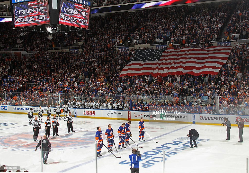 The New York Islanders and the Pittsburgh Penguins stand at attention during the national anthem prior to Game Three of the Eastern Conference Quarterfinals during the 2013 NHL Stanley Cup Playoffs at the Nassau Veterans Memorial Coliseum on May 5, 2013 in Uniondale, New York. The Penguins defeated the Islanders 5-4 in overtime.