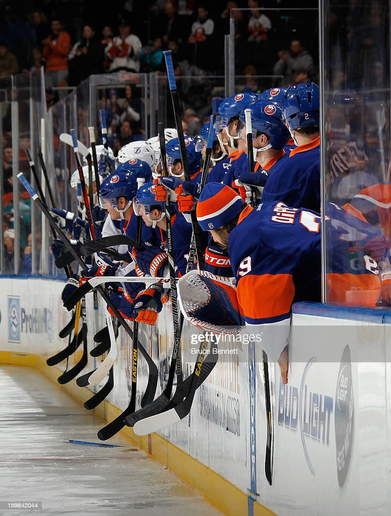 The New York Islanders and the Tampa Bay Lightning salute their two teammates who had fights in the first second of the game at the Nassau Veterans Memorial Coliseum on January 21, 2013 in Uniondale, New York.