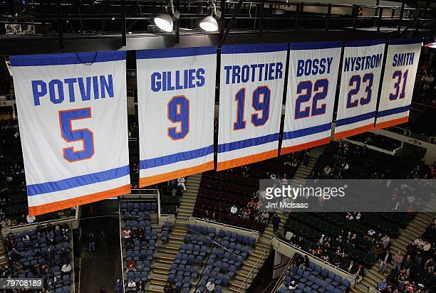 The New York Islanders banners honoring the retired jerseys of Denis Potvin Clark Gillies Bryan Trottier Mike Bossy Bob Nystrom and Bill Smith are...