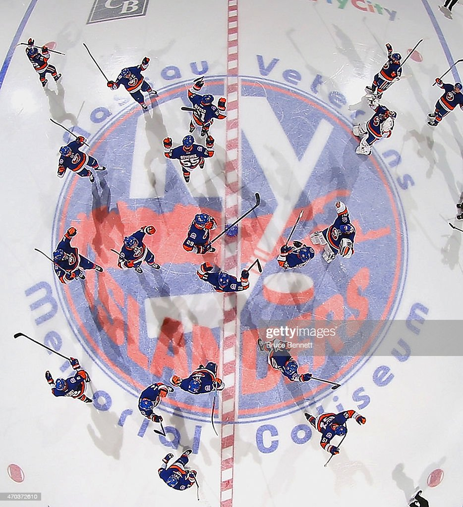 The New York Islanders celebrate a 21 overtime victory against the Washington Capitals in Game Three of the Eastern Conference Quarterfinals during...