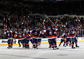 The New York Islanders celebrate a 63 victory over the Pittsburgh Penguins at the Nassau Veterans Memorial Coliseum on January 16 2015 in Uniondale...