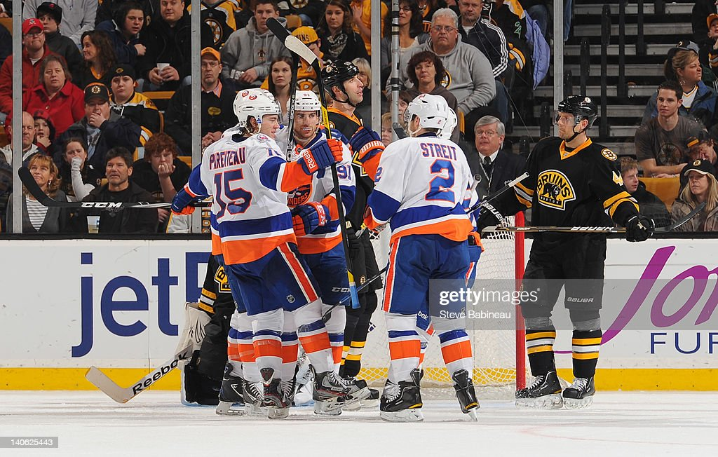 The New York Islanders celebrate a goal against the Boston Bruins at the TD Garden on March 3, 2012 in Boston, Massachusetts.