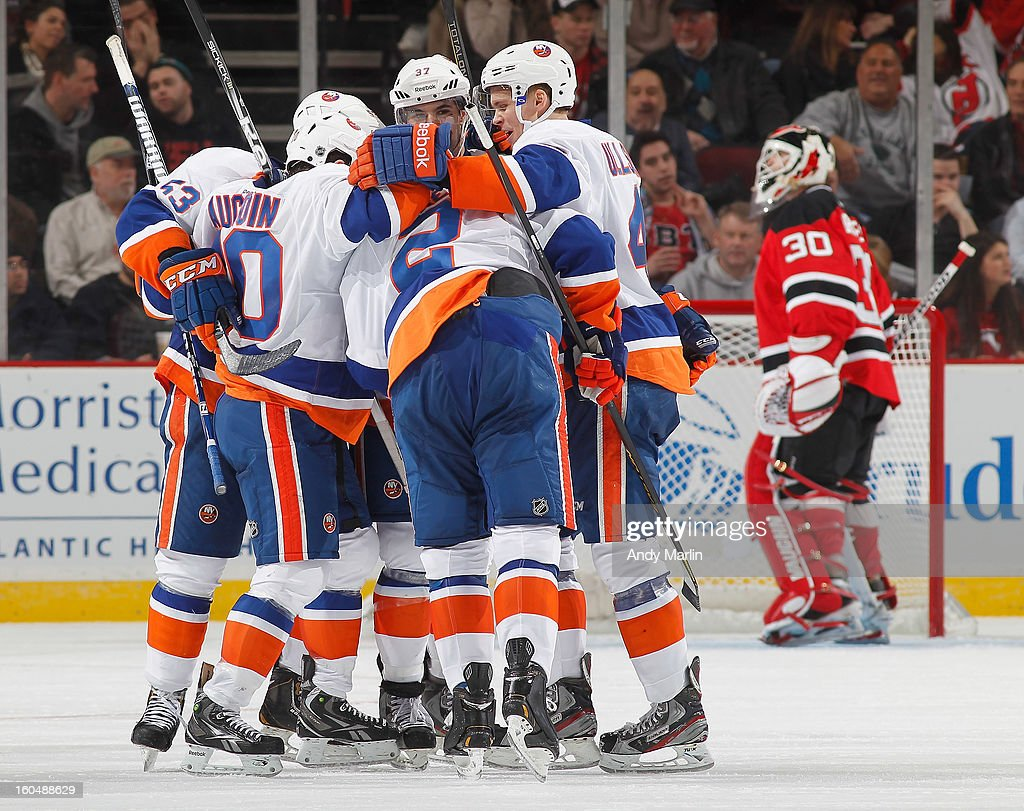 The New York Islanders celebrate a goal as Martin Brodeur #30 of the New Jersey Devils looks away during the game at the Prudential Center on January 31, 2013 in Newark, New Jersey.