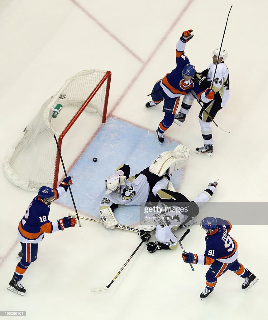 The New York Islanders celebrate a goal by <a gi-track='captionPersonalityLinkClicked' href=/galleries/search?phrase=John+Tavares&family=editorial&specificpeople=601791 ng-click='$event.stopPropagation()'>John Tavares</a> #91 in the third period against the Pittsburgh Penguins in Game Four of the Eastern Conference Quarterfinals during the 2013 NHL Stanley Cup Playoffs at the Nassau Veterans Memorial Coliseum on May 7, 2013 in Uniondale, New York. The Islanders defeated the Penguins 6-4.