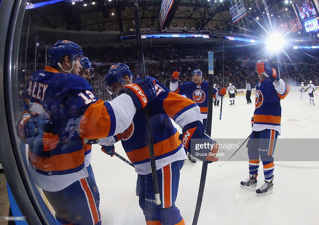 The New York Islanders celebrate a goal by Josh Bailey #12 (L) at 17:18 of the second period against the Pittsburgh Penguins at Nassau Veterans Memorial Coliseum on March 22, 2013 in Uniondale, New York.