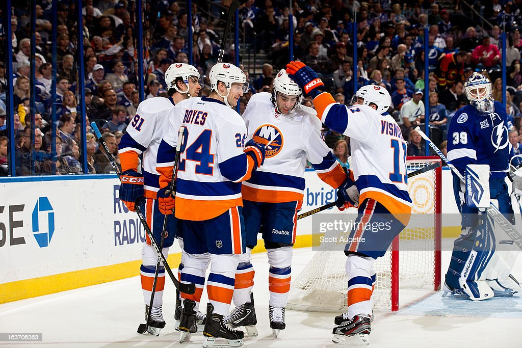 The New York Islanders celebrate after a goal by <a gi-track='captionPersonalityLinkClicked' href=/galleries/search?phrase=John+Tavares&family=editorial&specificpeople=601791 ng-click='$event.stopPropagation()'>John Tavares</a> #91 during the second period of the game against the Tampa Bay Lightning at the Tampa Bay Times Forum on March 14, 2013 in Tampa, Florida.