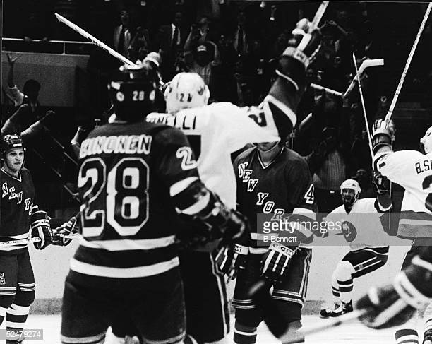 The New York Islanders celebrate Ken Morrow's overtime goal to defeat the rival New York Rangers in Game 5 of the Patrick Division semifinals at...