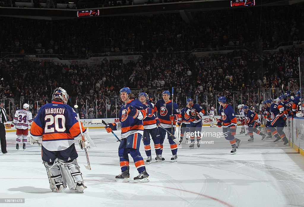 The New York Islanders celebrate their 4-3 shootout victory over the New York Rangers at the Nassau Veterans Memorial Coliseum on February 24, 2012 in Uniondale, New York.