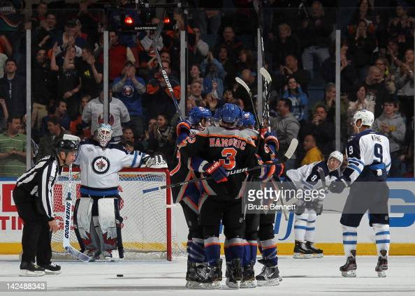 The New York Islanders celebrates the game winning goal by Michael Grabner at 1913 of the third period against Chris Mason of the Winnipeg Jets at...