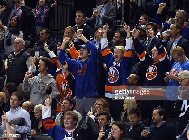 The New York Islanders fans celebrate a goal with the 'Yes Yes Yes' chant during the game against the Calgary Flames at the Barclays Center on...