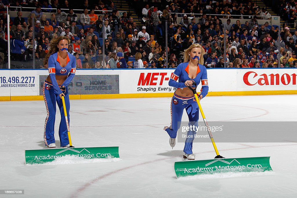 The New York Islanders ice girls celebrate 'Movember' by wearing fake mustaches as they clean the ice during the game between the New York Islanders and the Boston Bruins at the Nassau Veterans Memorial Coliseum on November 2, 2013 in Uniondale, New York.