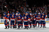 The New York Islanders leave the ice after defeating the Washington Capitals 43 in overtime in a game at the Nassau Veterans Memorial Coliseum on...