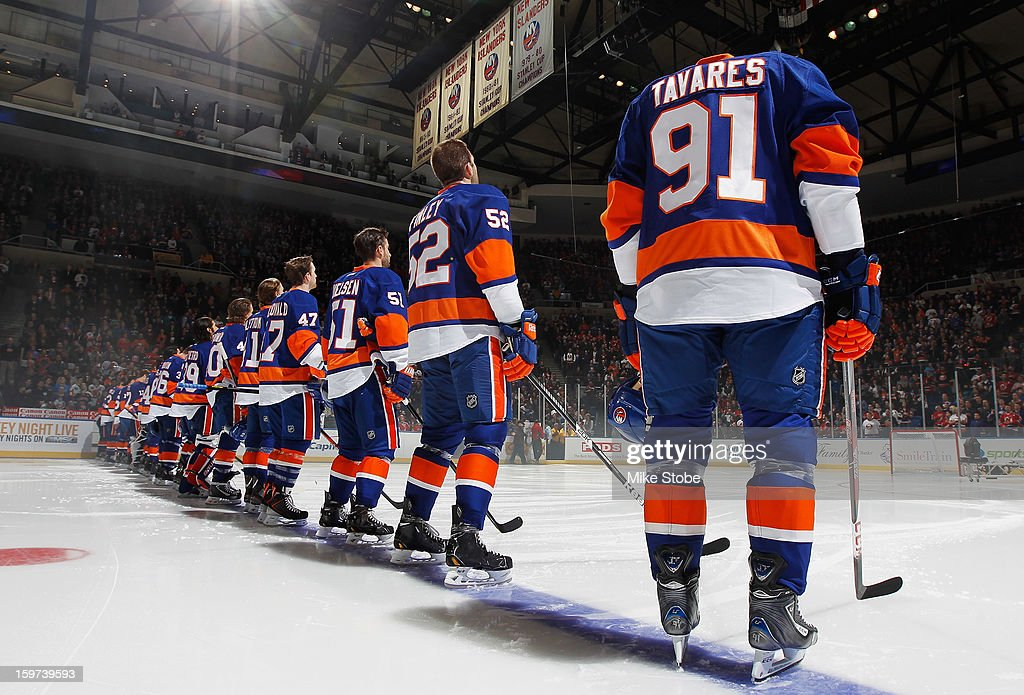 The New York Islanders line up prior to the 2013 home opener game against the New Jersey Devils at Nassau Veterans Memorial Coliseum on January 19, 2013 in Uniondale, New York. The Devils defeated the Islanders 2-1.