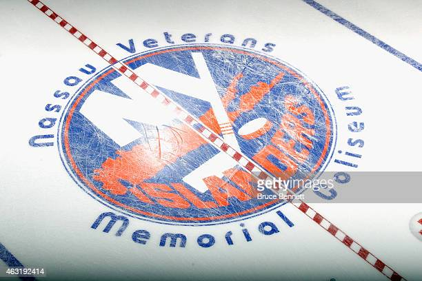 The New York Islanders logo at center ice as photographed prior to the game bettwen the Islanders and the Edmonton Oilers at the Nassau Veterans...
