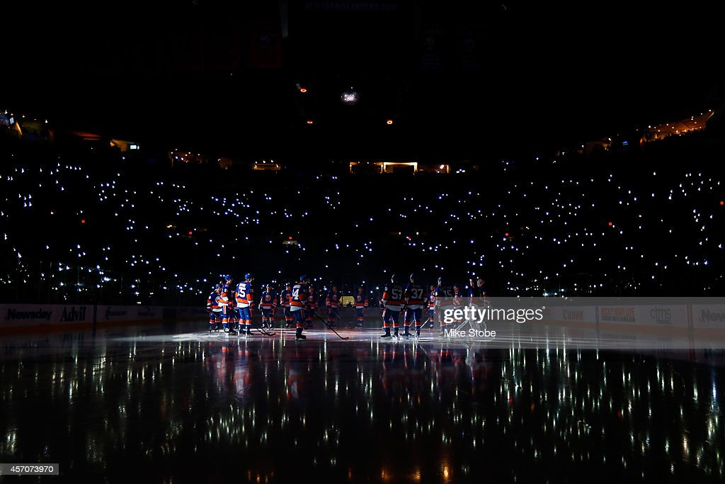 The New York Islanders salute the crowd prior to the home opener against the Carolina Hurricanes at Nassau Veterans Memorial Coliseum on October 11...