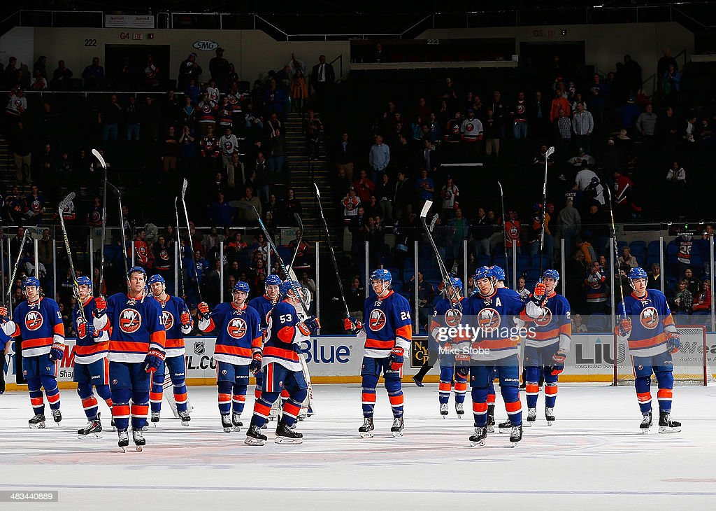 The New York Islanders salute their fans at the conclusion of their final home game of the 2013-2014 NHL season against Ottawa Senators at Nassau Veterans Memorial Coliseum on April 8, 2014 in Uniondale, New York. The Senators defeated the Islanders 4-1.