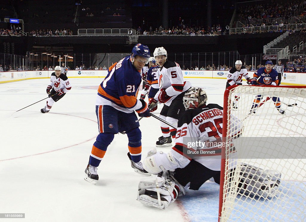 The New York Islanders skate against the New Jersey Devils during a preseason game at the Barclays Center on September 21, 2013 in Brooklyn borough of New York City.The game is the first professional hockey match to be held in the arena that is slated to be the new home for the Islanders at the start of the 2015-2016 season. The Devils defeated the Islanders 3-0.