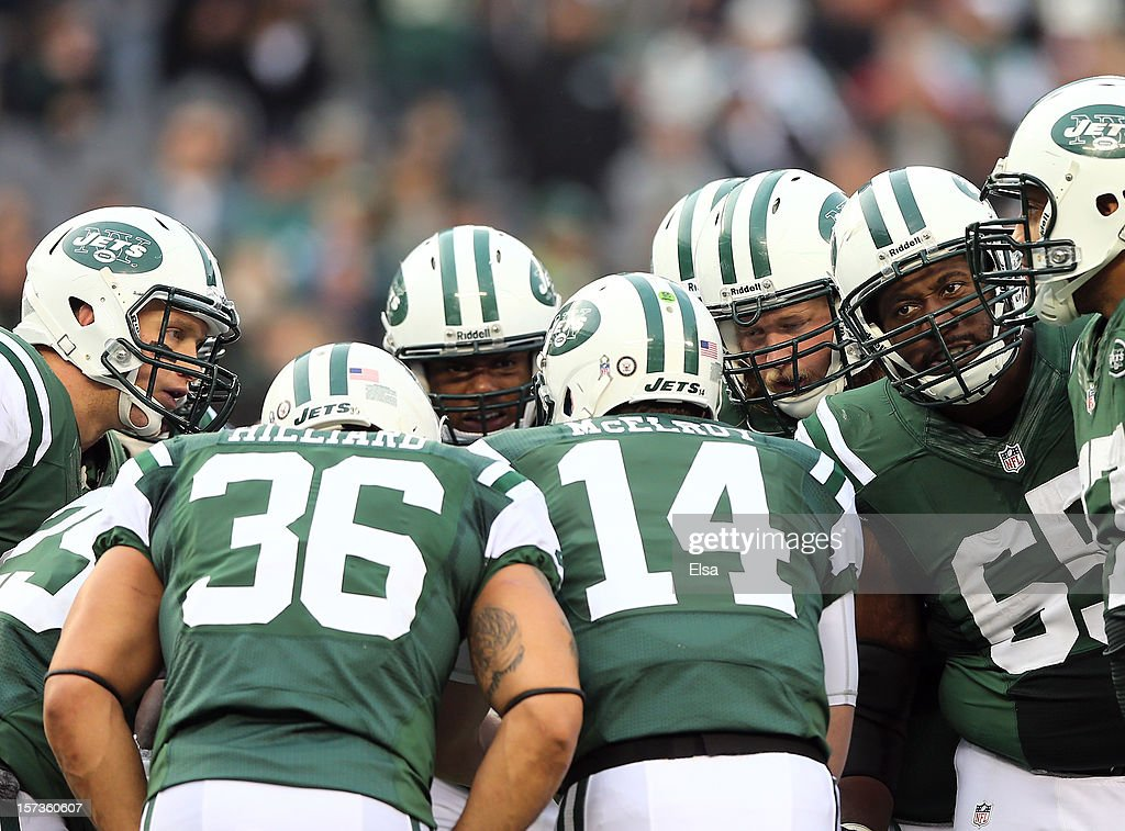 The New York Jets offense huddles around quarterback <a gi-track='captionPersonalityLinkClicked' href=/galleries/search?phrase=Greg+McElroy&family=editorial&specificpeople=5534586 ng-click='$event.stopPropagation()'>Greg McElroy</a> #14 in the third quarter against the Arizona Cardinals on December 2, 2012 at MetLife Stadium in East Rutherford, New Jersey. The New York Jets defeated the Arizona Cardinals 7-6.