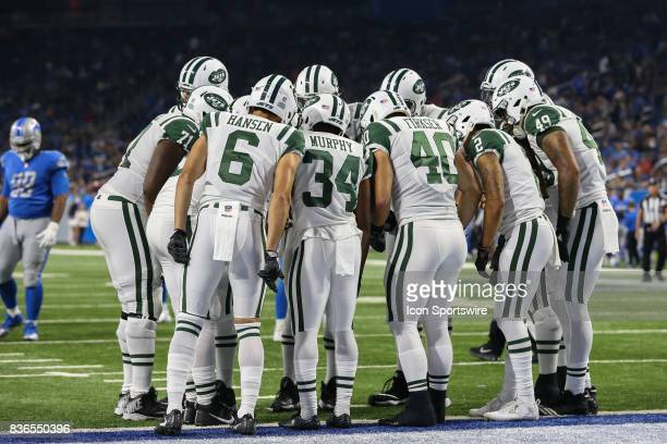 The New York Jets offensive line huddles together for a play during a preseason game between the New York Jets and the Detroit Lions on August 19...