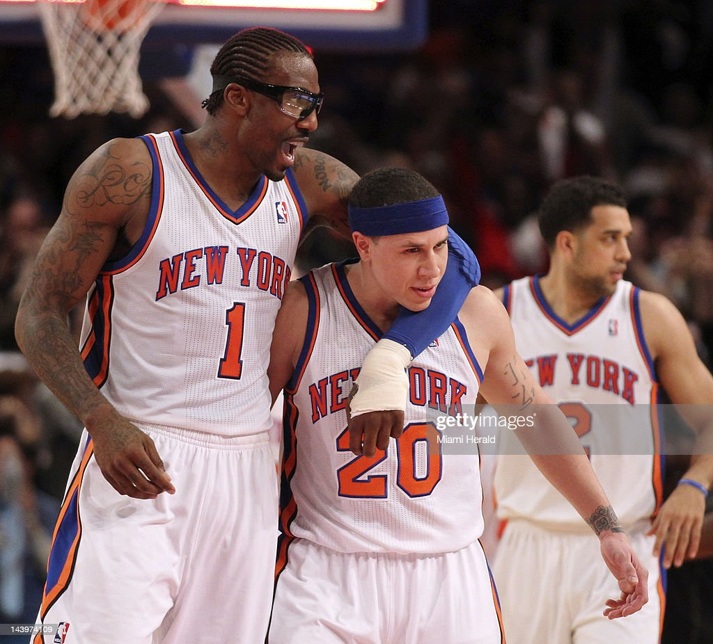 The New York Knicks' Amare' Stoudemire (1) grabs Mike Bibby after defeating the Miami Heat, 89-87, in Game 4 of the NBA Eastern Conference Quarterfinals at Madison Square Garden in New York City, Sunday, May 6, 2012.