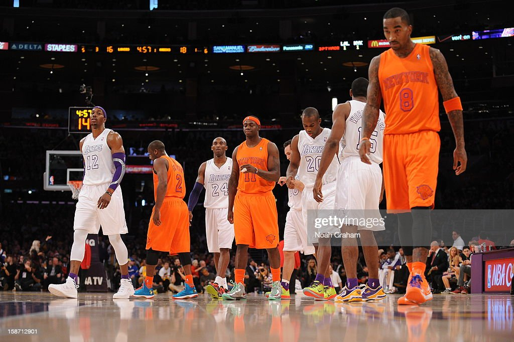 The New York Knicks and the Los Angeles Lakers walk onto the floor after a timeout in their game at Staples Center on December 25, 2012 in Los Angeles, California.