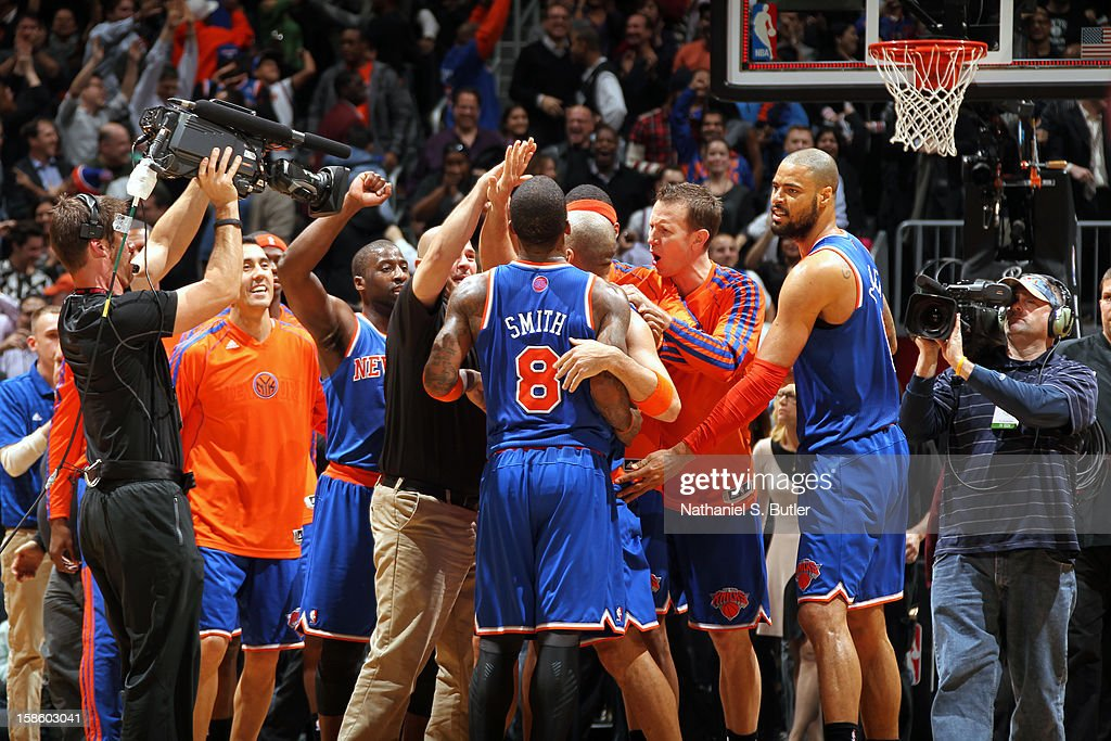 The New York Knicks celebrate a win against the Brooklyn Nets on December 11, 2012 at the Barclays Center in the Brooklyn borough of New York City.