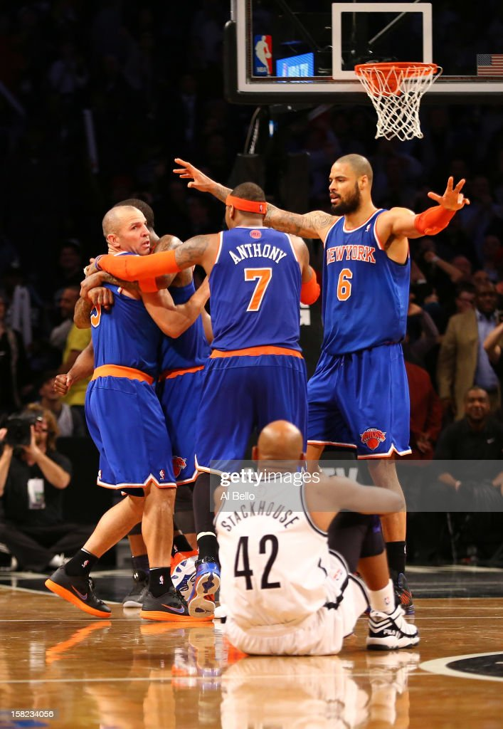 The New York Knicks celebrate with <a gi-track='captionPersonalityLinkClicked' href=/galleries/search?phrase=Jason+Kidd&family=editorial&specificpeople=201560 ng-click='$event.stopPropagation()'>Jason Kidd</a> #5 after he hit the winning three pointer against the Brooklyn Nets to win 100-97 during their game at the Barclays Center on December 11, 2012 in the Brooklyn borough of New York City.