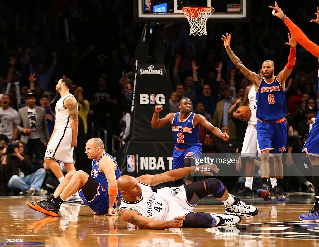 The New York Knicks celebrate with Jason Kidd #5 after he hit the winning three pointer against the Brooklyn Nets as Jerry Stackhouse #42 lies on the court to win 100-97 during their game at the Barclays Center on December 11, 2012 in the Brooklyn borough of New York City.