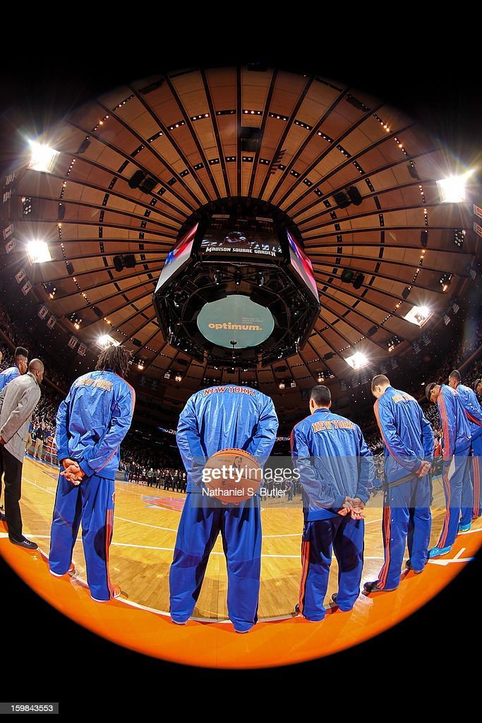 The New York Knicks listen to the National Anthem before playing against the Brooklyn Nets on January 21, 2013 at Madison Square Garden in New York City.