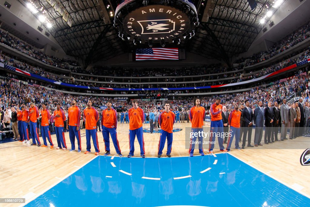 The New York Knicks stand for the National Anthem prior to a game against the Dallas Mavericks on November 21, 2012 at the American Airlines Center in Dallas, Texas.