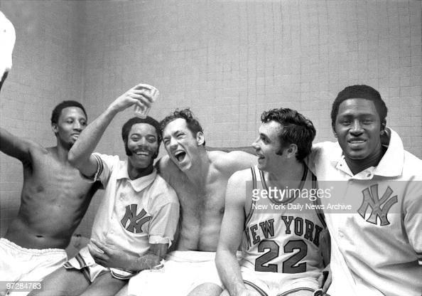 The New York Knicks' starting five Dick Barnett Walt Frasier Bill Bradley Dave DeBusschere and Willis Reed rejoice in the dressing room after winning...