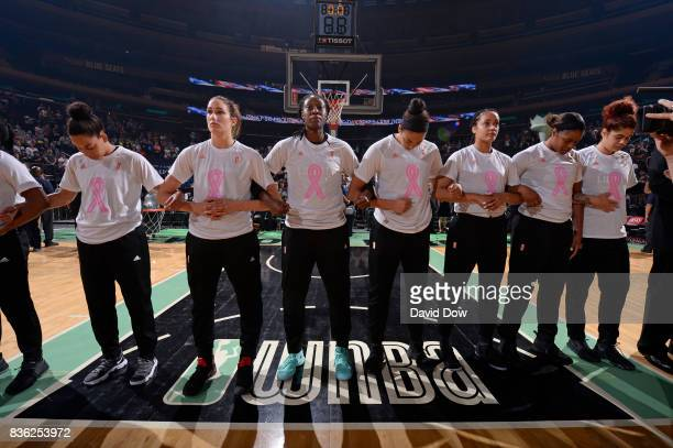 The New York Liberty players lock arms before the game against the Minnesota Lynx during the WNBA game on August 20 2017 at the Madison Square Garden...