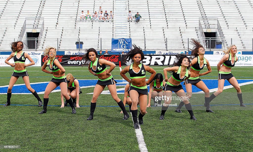 The New York Lizards dance team entertain during a timeout in the first half of a Major League Lacrosse game between the Lizards and Boston Cannons at James M. Shuart Stadium on April 28, 2013 in Hempstead, New York.