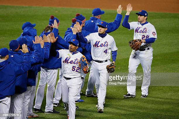 The New York Mets celebrate after defeating the Kansas City Royals by a score of 93 to win Game Three of the 2015 World Series at Citi Field on...