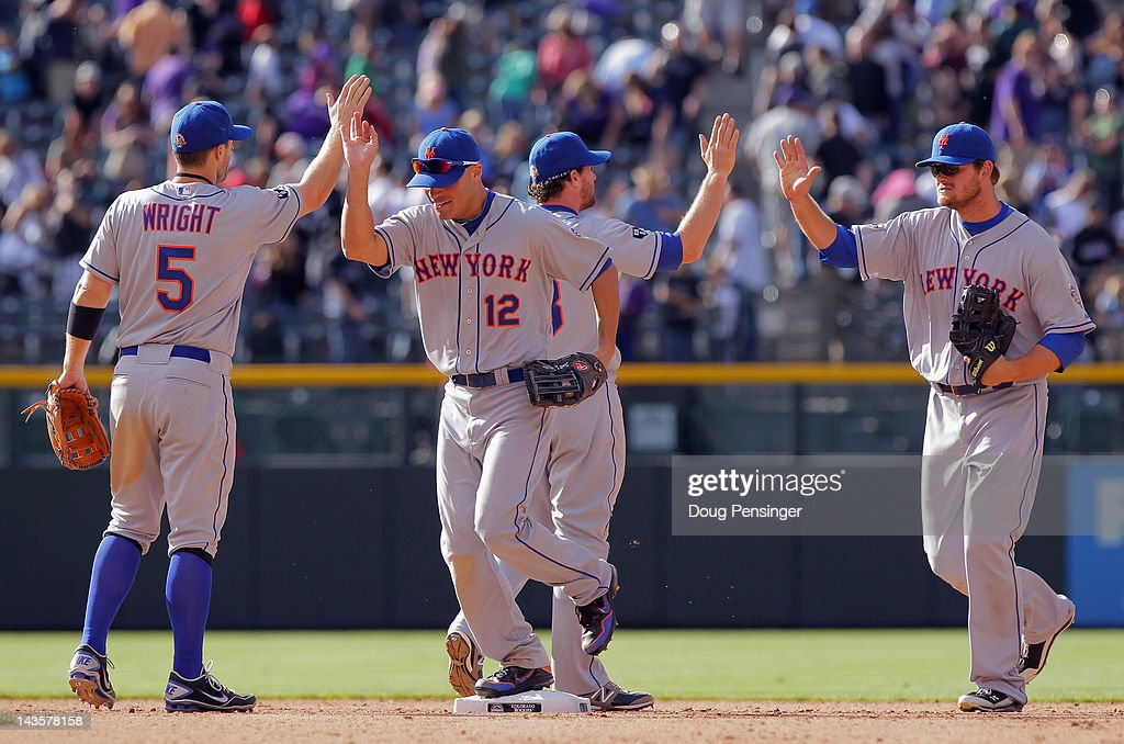 The New York Mets celebrate their victory over the Colorado Rockies at Coors Field on April 29, 2012 in Denver, Colorado. The Mets defeated the Rockies 6-5 in 11 innings.