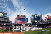 The New York Mets line up for the national anthem before the start of their Opening Day game against the Philadelphia Phillies on April 13 2015 at...