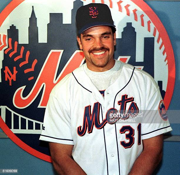 The New York Mets' Mike Piazza meets with the media at a press conference 23 May at Shea Stadium in New York City a few minutes after arriving at the...