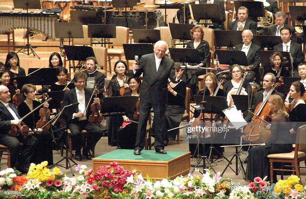 The New York Philarmonic musical director <a gi-track='captionPersonalityLinkClicked' href=/galleries/search?phrase=Lorin+Maazel&family=editorial&specificpeople=935587 ng-click='$event.stopPropagation()'>Lorin Maazel</a> (C) smiles before a North Korean audience in Pyongyang on February 26, 2008. The 105-member of the New York Philharmonic orchestra arrived in communist country on february 25 to play the music of Gershwin and Dvorak to break down barriers between the hardline nation and the US. AFP PHOTO / KCNA via KNS