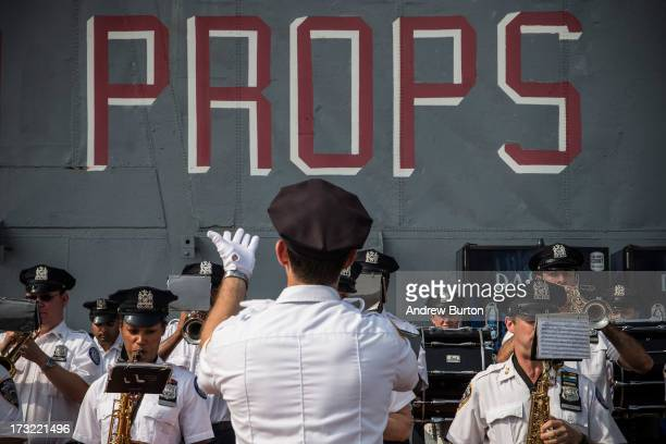 The New York Police Department Marching Band plays at the reopening of the Space Shuttle Enterprise's Pavilion housing on the flight deck of the...