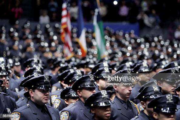The New York Police Department's Class of 2005 stand at attention as the colors are presented during their graduation from the NYPD Police Academy...
