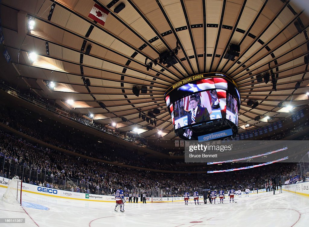 The New York Rangers and the Montreal Canadiens stand at attention during the national anthem prior to their gam at Madison Square Garden on October 28, 2013 in New York City.