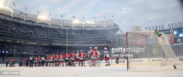 The New York Rangers and the New Jersey Devils shakes hands following the 2014 Coors Light NHL Stadium Series game at Yankee Stadium on January 26...